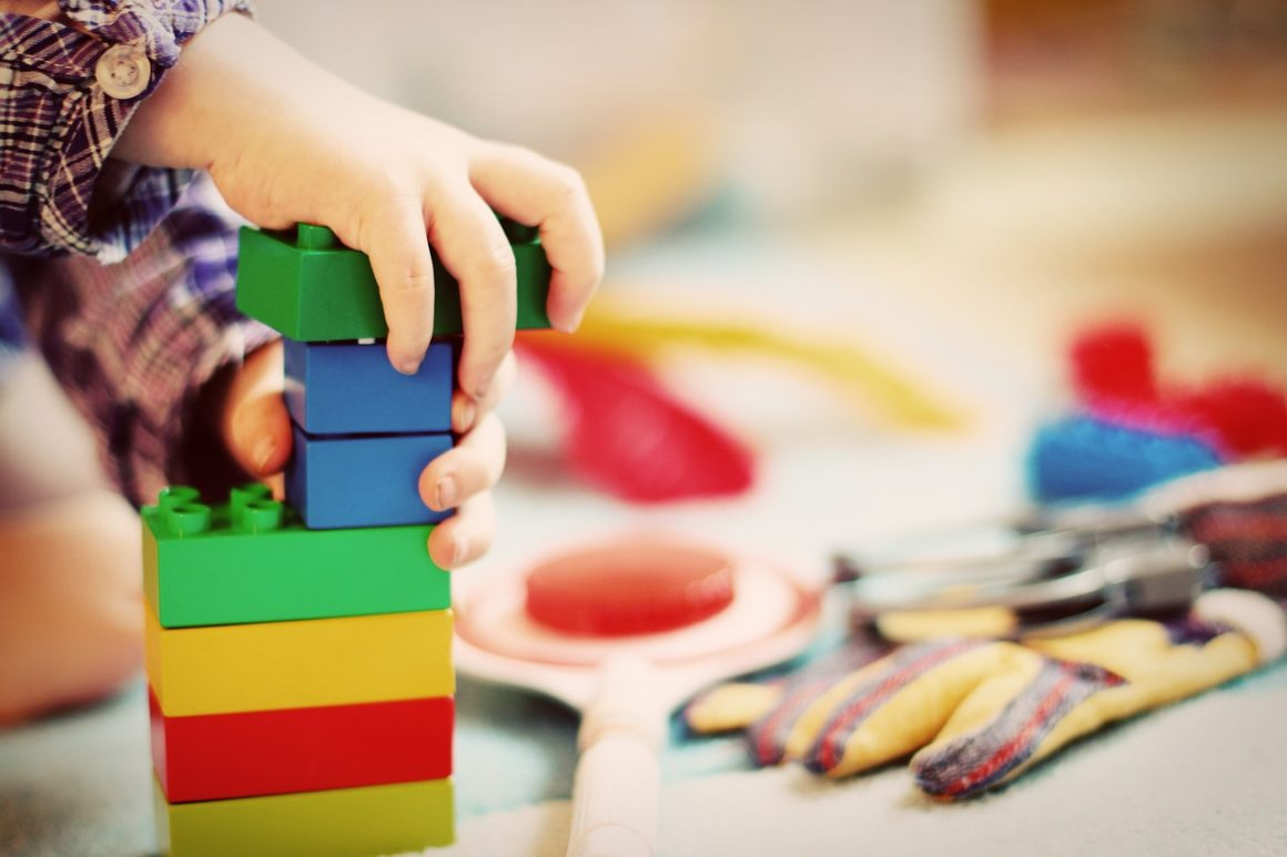 child playing with best toys for speech and language