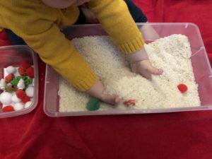 Rice Bin sensory toddler hands close up