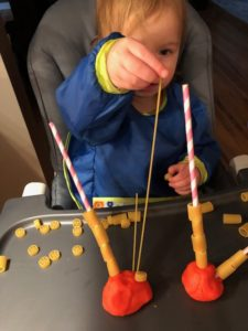 get toddler to talk with pasta threading activity