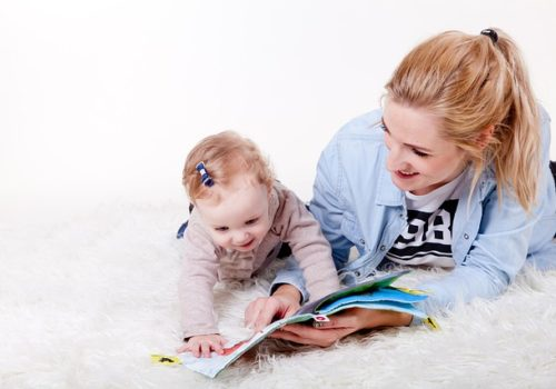 Mother reading with baby to encourage language development