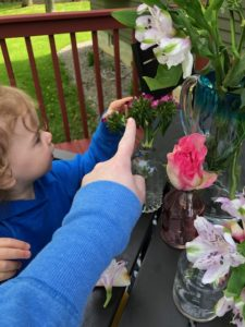 preschooler pointing to flower in pretend play